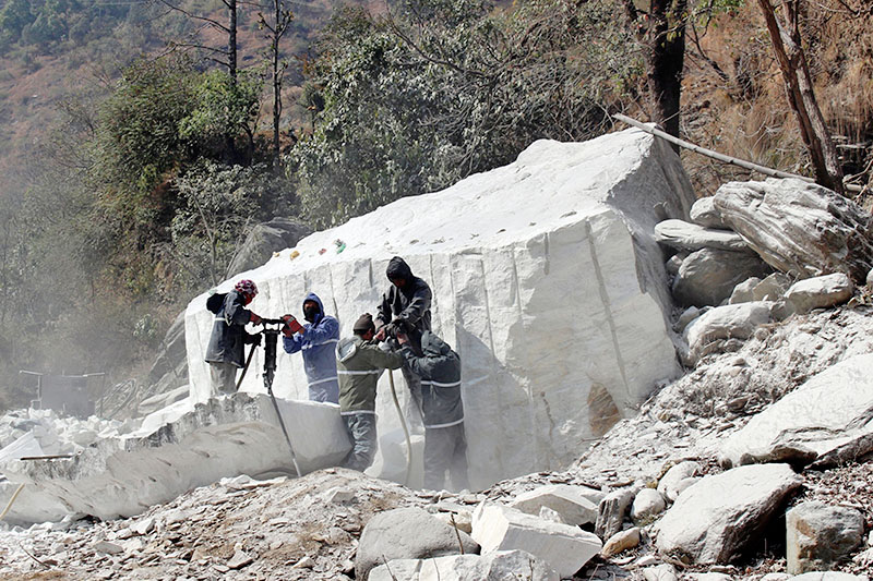 Labourers use jack-hammar to break stone for the construction of Beni-Jomsom road section in Myagdi district, on Monday, February 05, 2018. Photo: RSS