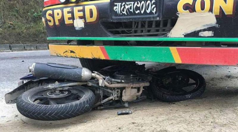 A motorcycle comes under a truck after colliding with it  near Kalika Temple in Gajuri Rural Municipality-1 of Dhading district, on Saturday, February 24, 2018. Photo: THT