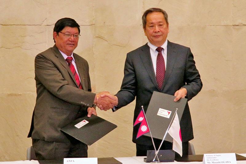 Dhirendra Kumar Pradhan, General Secretary of ANFA (left) and Masashi Ogawa, Ambassador of Japan to Nepal shake hands after signing an MoU in Kathmandu, on Wednesday, February 28, 2018. Photo courtesy: Japanese Embassy in Kathmandu