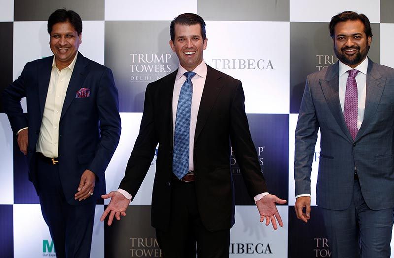 Donald Trump Jr gestures as Basant Bansal, Chairman and Managing Director of M3M India and Kalpesh Mehta, founder of Tribeca Developers, look on during a photo opportunity before start of a meeting in New Delhi, India, on February 20, 2018. Photo: Reuters