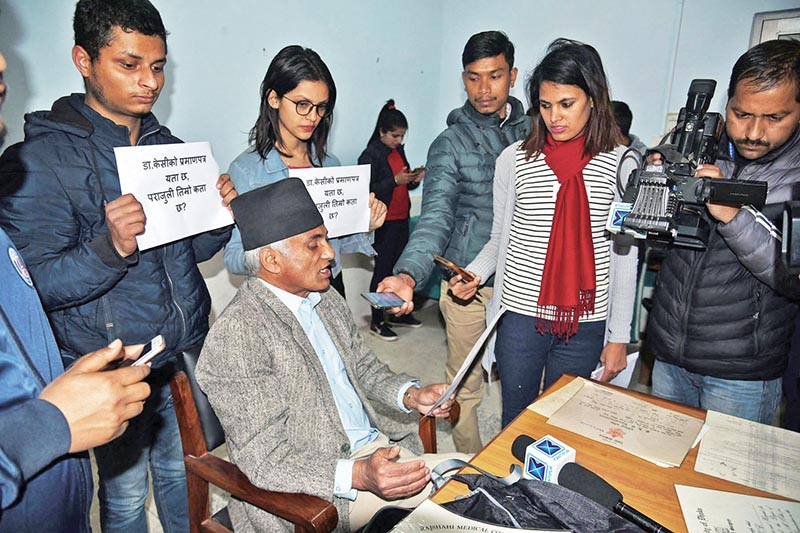 Dr Govinda KC answering journalistsu2019 queries at a press meet organised to make public his citizenship and academic certificates, in Kathmandu, on Wednesday, February 21, 2018. Photo: THT