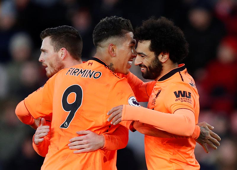 Liverpool's Mohamed Salah celebrates scoring their second goal with Roberto Firmino and Andrew Robertson during the Premier League between Southampton and Liverpool, at St Mary's Stadium, in Southampton, Britain, on February 11, 2018. Photo: Reuters