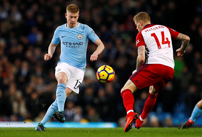 Manchester City's Kevin De Bruyne in action with West Bromwich Albion's James McClean during the Premier League match between Manchester City and West Bromwich Albion, at Etihad Stadium, in Manchester, Britain, on January 31, 2018. Photo: Action Images via Reuters