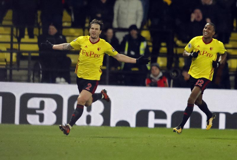 Watford's Daryl Janmaat (left), celebrates after scoring during the English Premier League soccer match between Watford and Chelsea at Vicarage Road stadium in London, on Monday, February 5, 2018. Photo: AP