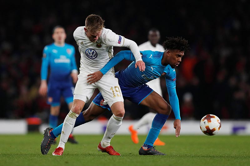 Arsenal's Alex Iwobi in action with Ostersunds FK's Dennis Widgren during the Europa League Round of 32 Secon Leg match between Arsenal and Ostersunds FK, at Emirates Stadium, in London, Britain, on February 22, 2018. Photo: Action Images via Reuters