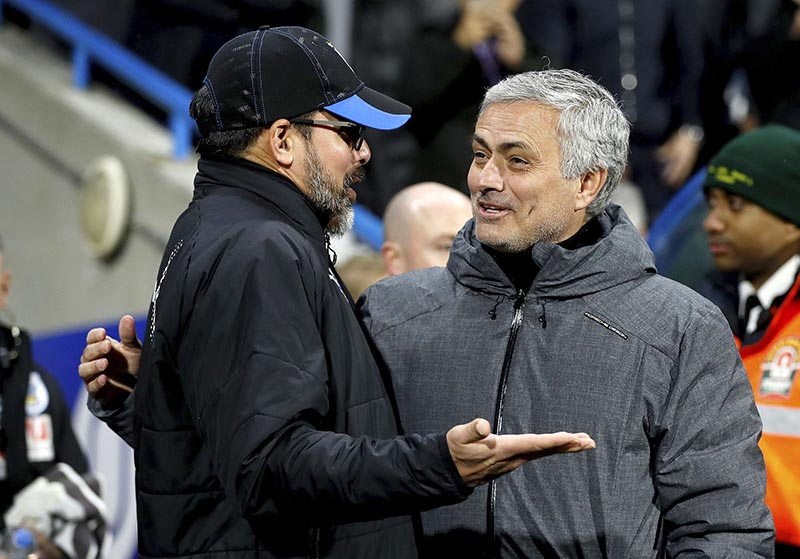 Huddersfield Town manager David Wagner (left), and Manchester United manager Jose Mourinho speak before the English FA Cup, fifth round soccer match at The John Smith's Stadium, Huddersfield, England, on Saturday February 17, 2018. Photo: Martin Rickett/PA via AP