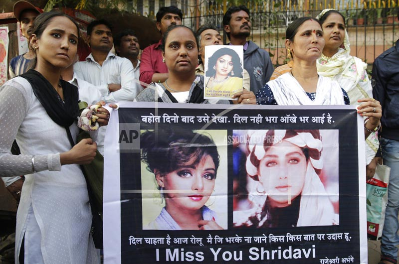 Fans of Bollywood actress Sridevi hold posters as they wait outside her residence to pay their last respects in Mumbai, India, Wednesday, February 28, 2018. Photo: AP