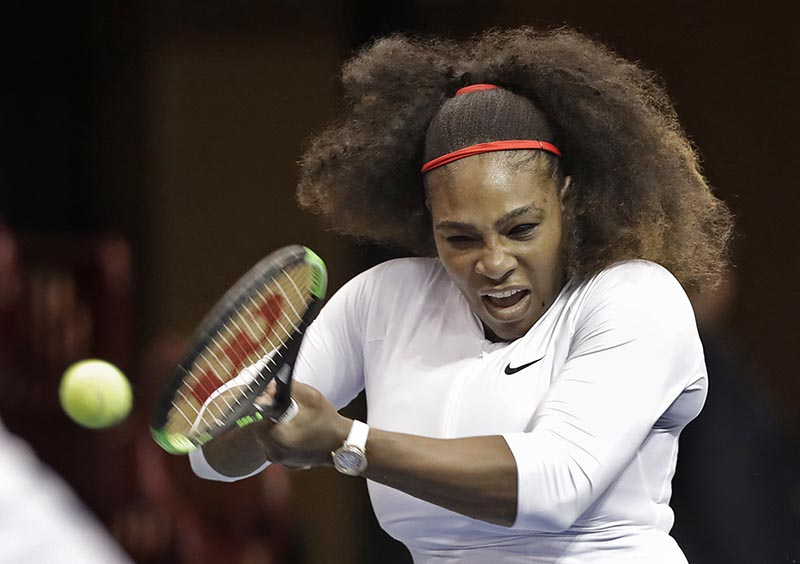 USA's Serena Williams returns a shot against the Netherlands during a doubles match in the first round of Fed Cup tennis competition in Asheville, NC, on Sunday, February 11, 2018. Photo: AP