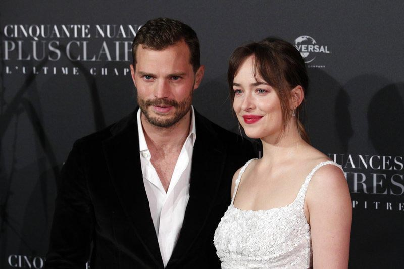 File - Jamie Dornan, left, and Dakota Johnson pose during a photocall for the world premiere of u0091Fifty Shades Freed - 50 Nuances Plus Clairesu0092 at Salle Pleyel in Paris, on Tuesday, Feb. 6, 2018. Photo: AP