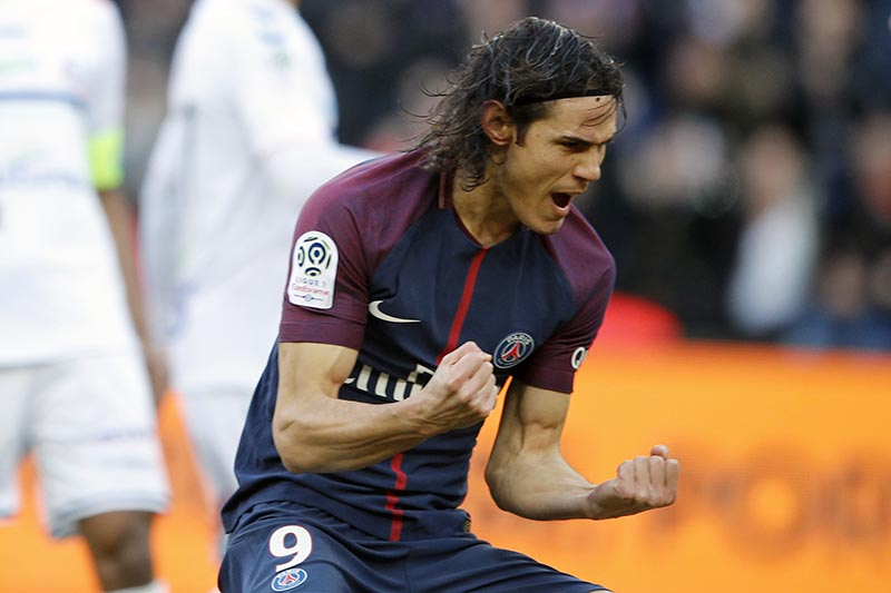 PSG's Edinson Cavani celebrates his goal during the French League One soccer match between Paris Saint Germain and Strasbourg, at the Parc des Princes stadium in Paris, France, on Saturday, February 17, 2018. Photo: AP