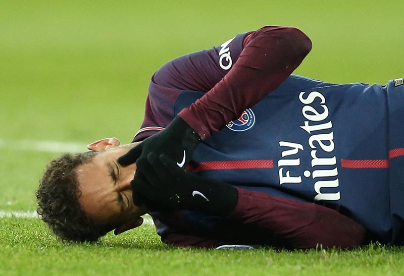 Paris Saint-Germainu2019s Neymar lies on the pitch after sustaining an injury  during the French Ligue 1 match between Paris St Germain and Olympique de Marseille, at Parc des Princes, in Paris, France, on February 25, 2018. Photo: Reuters
