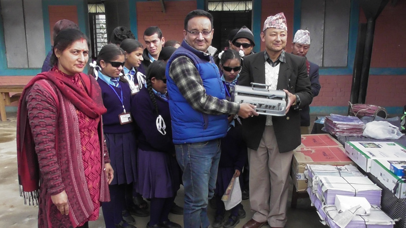 Bir Bahardur Thapa, District Educational Officer (DEO) hands over the educational materials obtained from Round Table to Manojdhoj Thamsuhang, Principal of Gadi Secondary School. Photo: Laxmi Gautam