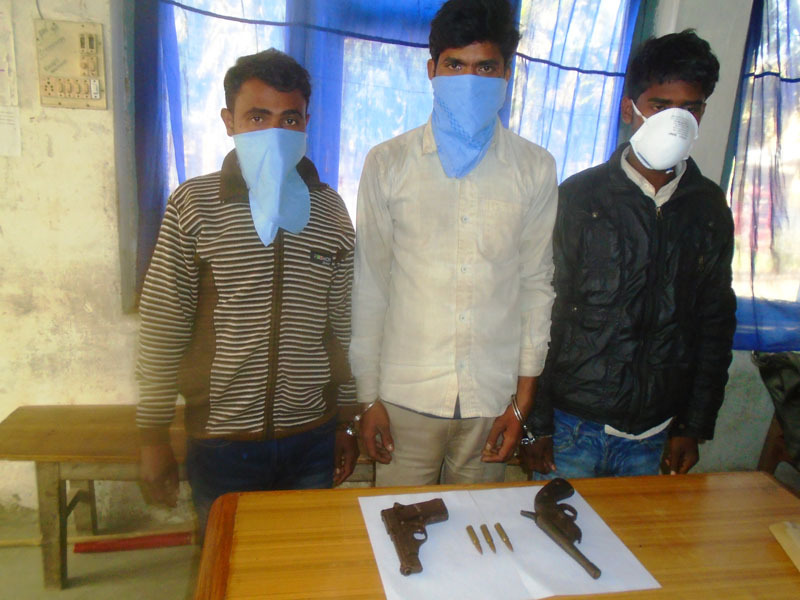 The arrestees made public by the Rautahat District Police office along with the illegal weapons and bullets in Rautahat on Tuesday, February 20, 2018. Photo: Prabhat Kumar Jha