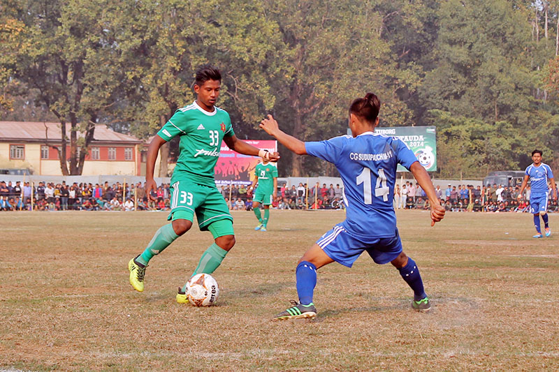 Tribhuvan Army Club (green jersey) player tries to dribble past Farwest XI player during the 3rd Tuborg Hetauda Gold Cup, on Monday, February 19, 2018. Photo: Prakash Dahal
