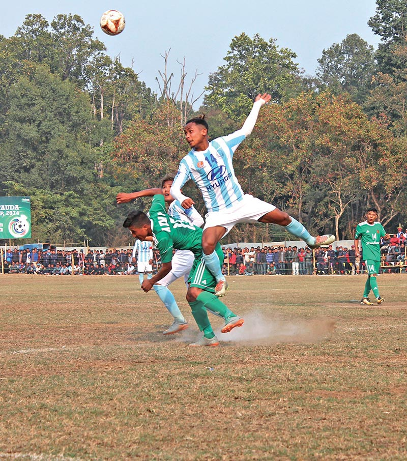 Players of Tribhuvan Army Club and Laxmi Hyundai MMC (right) vie for the ball during their third Hetauda Gold Cup match in Makawanpur on Wednesday. Photo: THT
