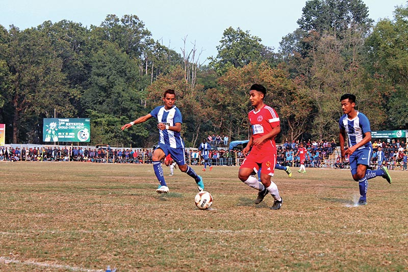 Players of Nepal Police Club (centre) and CMG Club Sankata in action during the third Hetauda Gold Cup at the Institute of Forestry grounds in Makawanpur on Thursday. Photo: THT