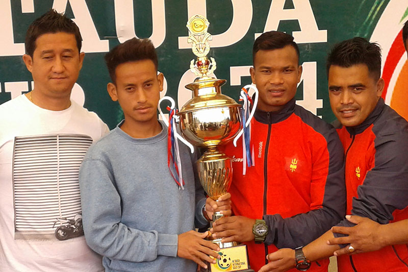 TAC and NPC captains and coaches pose with Hetauda Gold Cup trophy prior to their title showdown tomorrow, in Hetauda, on Friday, February 23, 2018. Photo: Prakash Dahal
