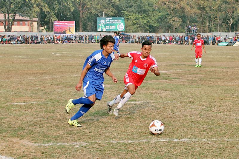 Bijaya Youth Club (blue) make a surging run forward with a ball against Nepal Police Club during 3rd Tuborg Hetauda Gold Cup, on Sunday, February 18, 2018. Photo: Prakash Dahal