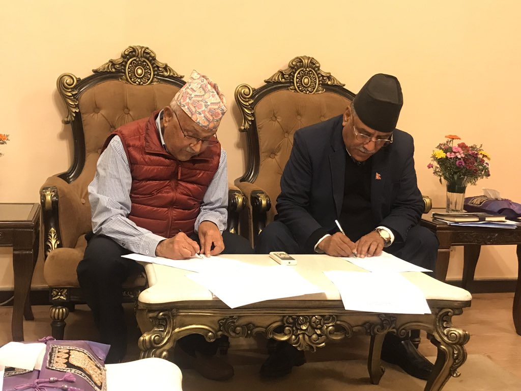 Leaders of ruling left coalition sign a seven point agreement on unification of the two communist parties. Photo: CPN-UML Secretary Pradeep Gyawali/ Twitter
