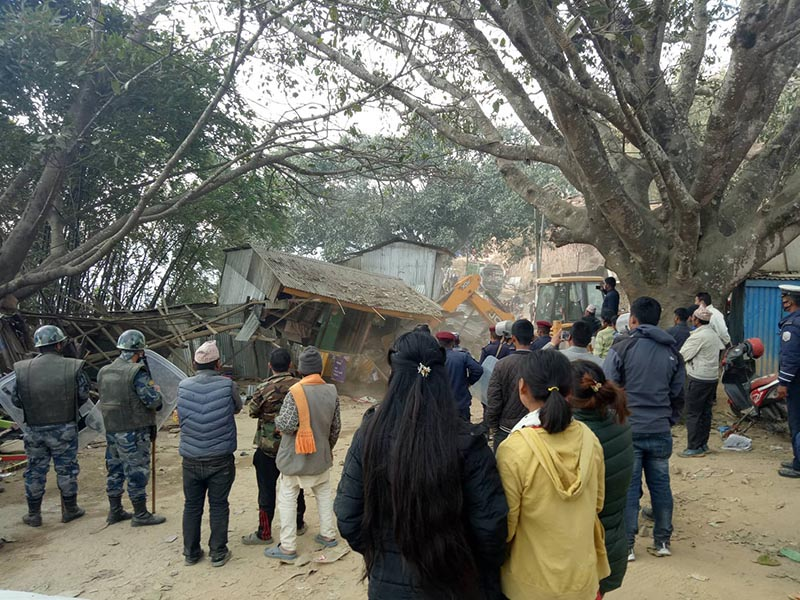 A dozer being used to demolish illegal structures in Halesi, Khotang, on Friday, February 23, 2018. Photo: THT
