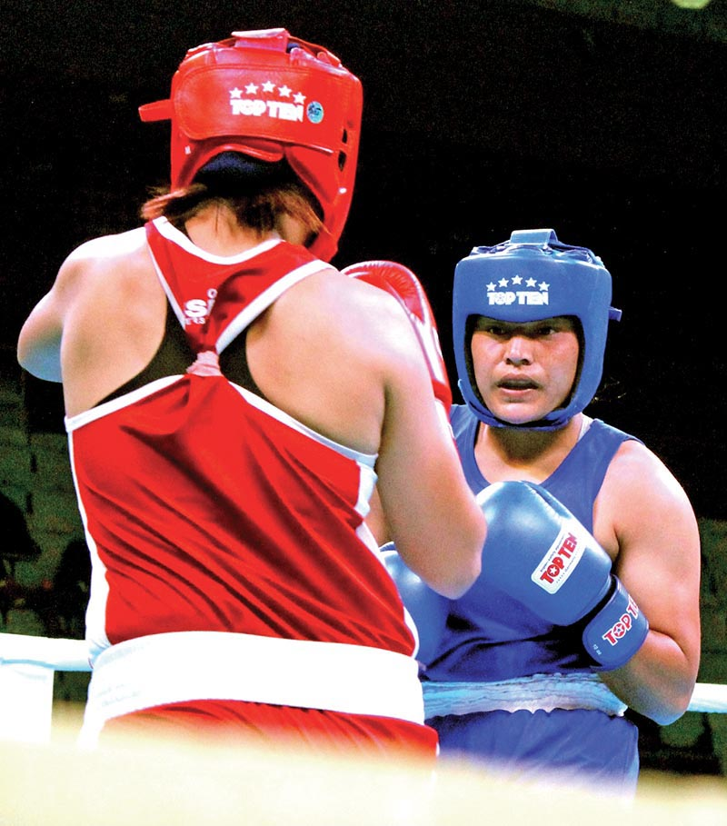 Nepalu2019s Punam Rawal fights against Indiau2019s Basumatary Pwilao (left) during their Indian Open International Boxing Tournament bout in New Delhi on Wednesday. Photo: NSJF
