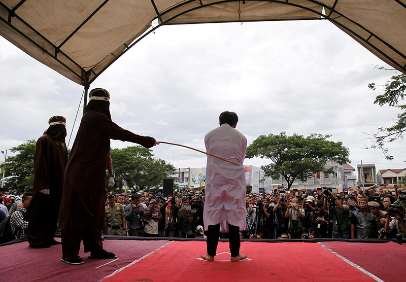 An Indonesian man is publicly caned for having gay sex in Banda Aceh, Aceh province, Indonesia, on May 23, 2017. Photo: Reuters/ File