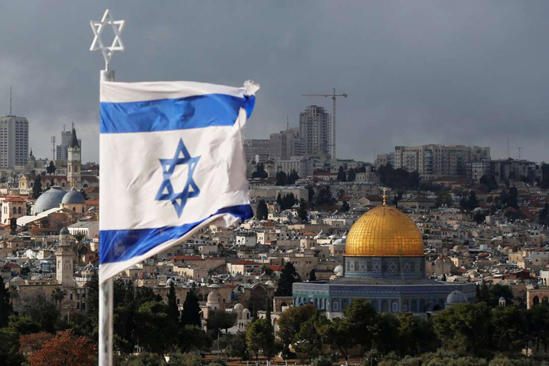 An Israeli flag is seen near the Dome of the Rock in Jerusalem's Old City on the compound known to Muslims as Noble Sanctuary and to Jews as Temple Mount on Wednesday.