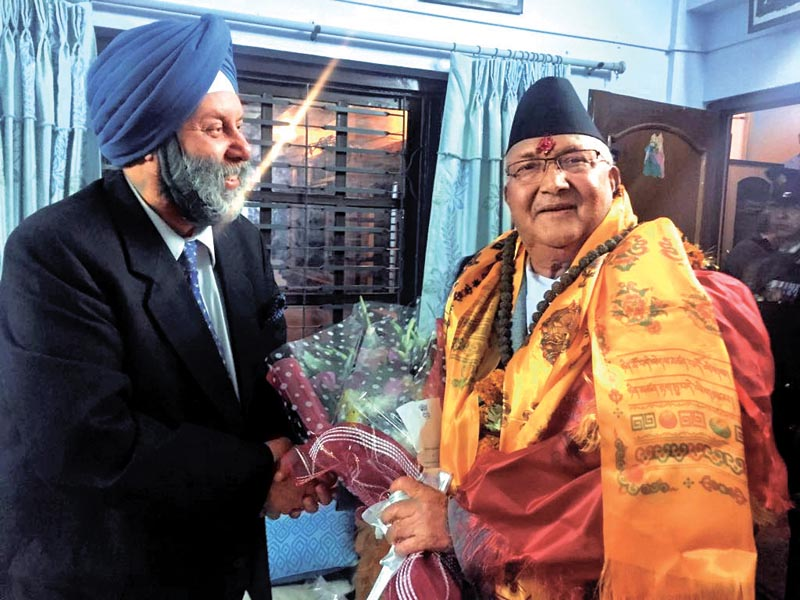 Insian Ambassador Manjeev Singh Puri congratulating Prime Minister KP Sharma Oli at the latter's residence in Balkot, Bhaktapur, on Thursday, February 15, 2018. Photo: THT