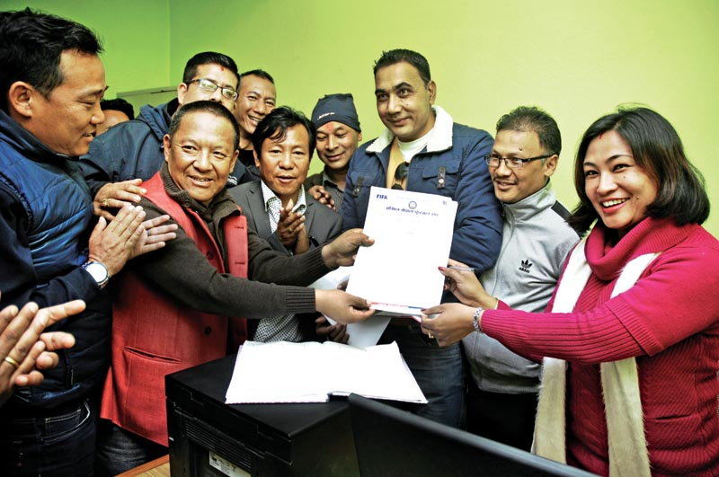 Karma Tshiring Sherpa (second from left) with supporters after filing his candidacy for ANFA President at the ANFA Complex in Lalitpur on Friday, February 16, 2018. Photo: THT