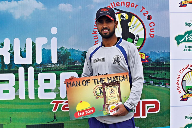 Rautahat Rising-XI skipper AashuKandoi holds the man-of-the-man award after their Khukuri Challenger T20 Cup match against Tikapur Cricket Club at the Mulpani cricket grounds on Wednesday. Photo: THT
