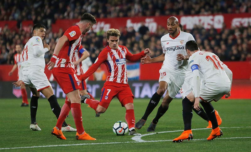 Atletico Madridu2019s Antoine Griezmann scores their second goal during the La Liga Santander match between Sevilla and Atletico Madrid , at Ramon Sanchez Pizjuan, in Seville, Spain, on February 25, 2018. Photo: Reuters