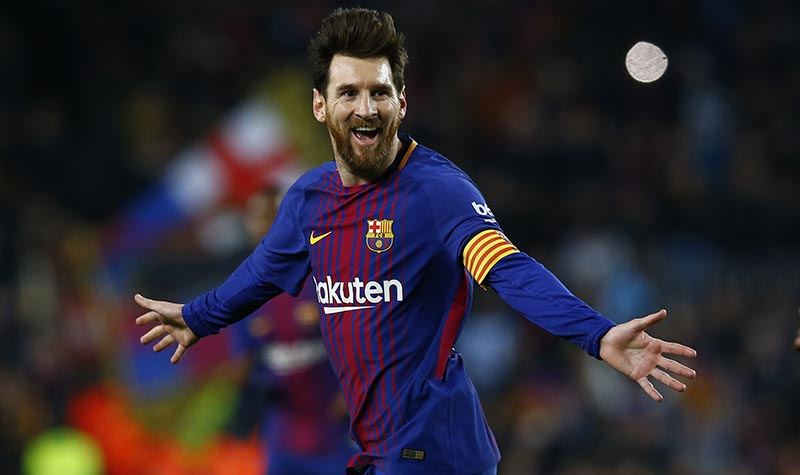 FC Barcelona's Lionel Messi celebrates after scoring during the Spanish La Liga soccer match between FC Barcelona and Girona at the Camp Nou stadium in Barcelona, Spain, on Saturday, February 24, 2018. Photo: AP