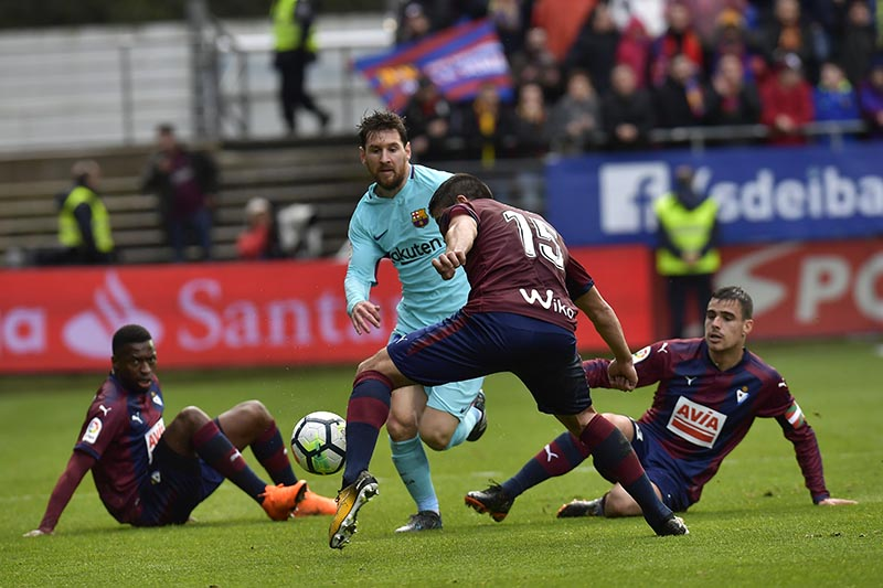 FC Barcelona's Lionel Messi competes for the ball with players from SD Eibar's Cote during the Spanish La Liga soccer match between FC Barcelona and SD Eibar, at Ipurua stadium, in Eibar, northern Spain, on Saturday, February 17, 2018. Photo: AP