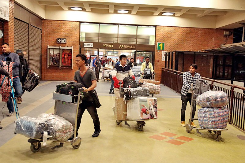 Migrant workers returning home at Tribhuvan International Airport in Kathmandu, on Sunday, February 18, 2018. Photo: RSS