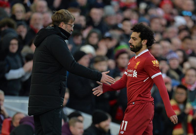 Liverpool manager Juergen Klopp shakes the hand of Mohamed Salah as he is substituted off in Liverpool FC vs West Ham United in Anfield, Liverpool, Britain. Photo: Reuters