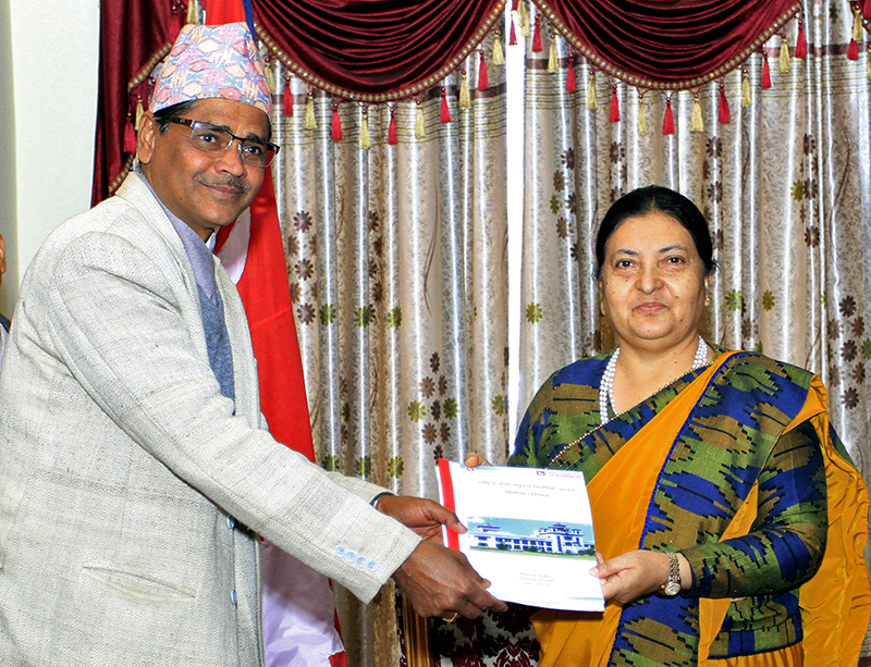 Chief Election Commissioner Ayodhee Prasad Yadav submits the final results of the National Assembly election to President Bidya Devi Bhandari at the latter's office, Shital Niwas, in Maharajgunj, on Sunday, February 11, 2018. Courtesy: President's Office