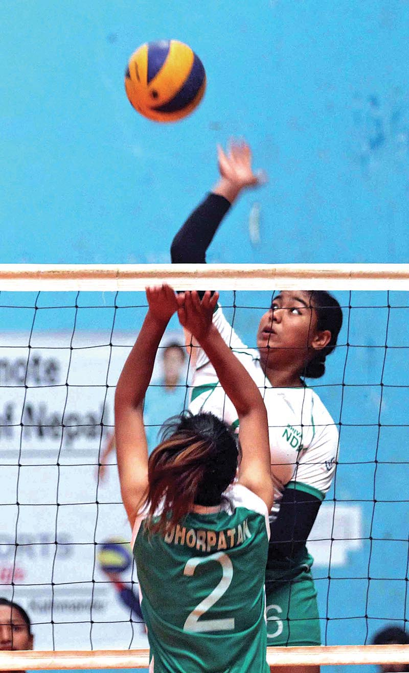 NDAu2019s Pratibha Mali (right) jumps up for a spike against Dhorpatan Sports Club during the NST-NVA Club Volleyball Championship in Kathmandu on Tuesday. Photo: THT