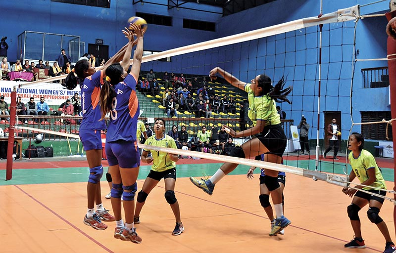 NPCu2019s Kopila Upreti (right) jumps for a spike against Nepal APF Club during their NST-NVA Club Volleyball Championship match at the National Sports Council covered hall in Kathmandu on Sunday. Photo: Naresh Shrestha/ THT