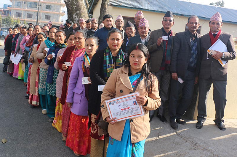 Voters waiting in queue showing their identity cards on the premises of Public Service Commission Western Regional Directorate in Pokhara, Province 4, on Wednesday, February 7, 2018.  The National Assembly election is taking place in six provinces in the country. Photo: RSS