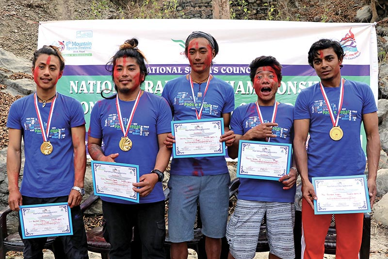 Paddle Nepal u2018Au2019 team members pose for a photo after winning the National Rafting Championship in Fishling, Chitwan on Tuesday. Photo: THT