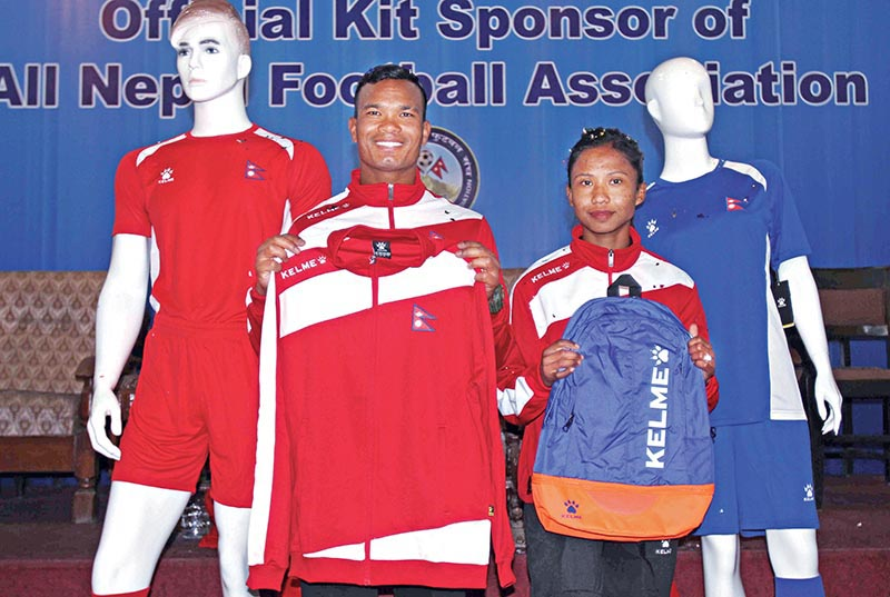 National menu2019s team vice-captain Bharat Khawas and womenu2019s team skipper Renuka Nagarkote unveiling the new gears at a programme in Lalitpur on Thursday. Photo: THT