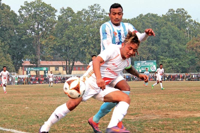 Laxmi Hyundai MMC defender Biraj Maharjan vies for the ball with Nepal APF Club player (front) during their third Hetauda International Gold Cup match in Hetauda on Saturday, February 17, 2018. Photo: THT