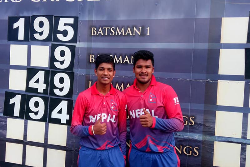 Sandeep Lamichhane and Karan KC (right) celebrating after helping Nepal win ICC World Cricket League nDivision-II match against Canada at the Wanderers Cricket Ground, in Windhoek, Namibia, on Wednesday, February 14, 2018. Photo courtesy: Raman Shiwakoti