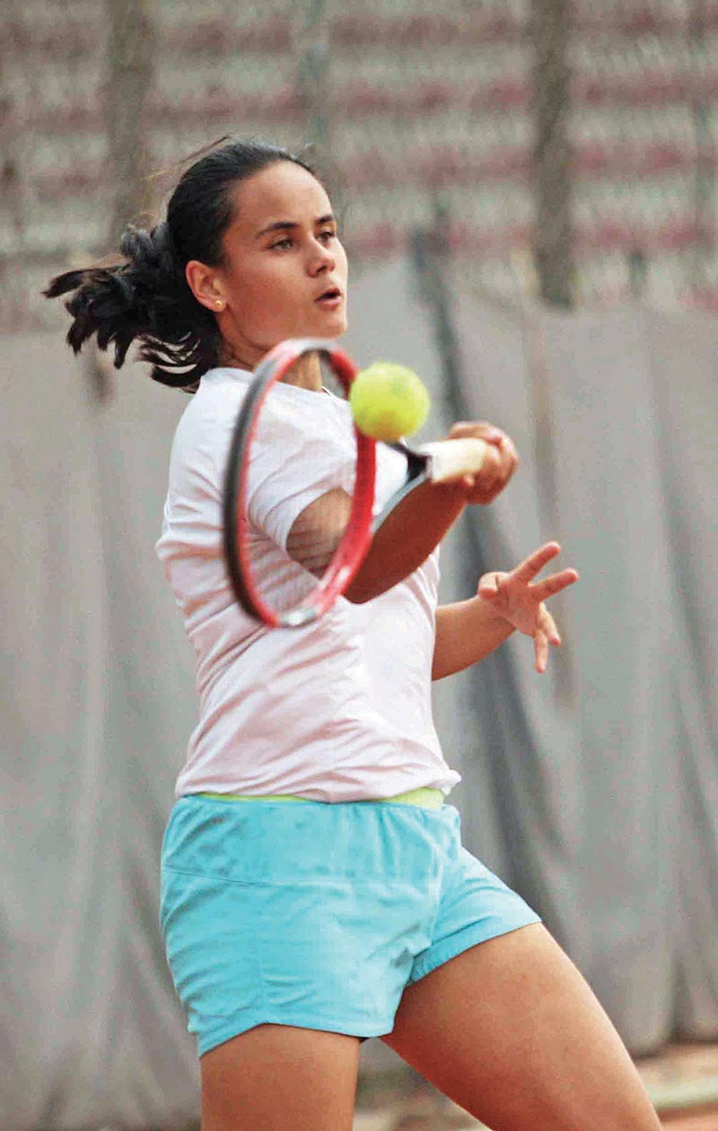 Anne Mathema returns to Charitha Patlolla of India in girls singles during Nepal ITF Juniors U-18 Circuit-I Tournament at the Satdobato Tennis Complex courts in Lalitpur on Tuesday. Photo: Udipt Singh Chhetry