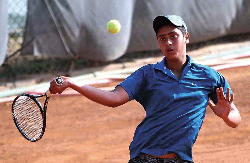 Nepalu2019s PranavKhanal returns to Aditya Chopra of India during their Nepal ITF Juniors U-18 Circuit-I Tournament match in Lalitpur on Monday. Photo: Udipt Singh Chhetry/THT