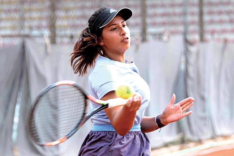 Nepalu2019s Mayanka Rana returns to Indiau2019s Khushi Sharma during their girlsu2019 singles match of the Nepal ITF Juniors U-18 Circuit-II at the Satdobato Tennis Complex in Lalitpur on Tuesday. Photo: Udipt Singh Chhetry/ THT