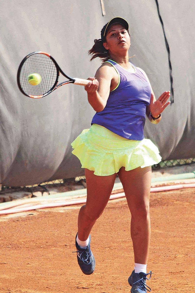Mayanka Rana returns to Ira Mehernissa Rawat during their Nepal ITF Juniors U-18 Tournament Circuit-II match in Lalitpur on Wednesday. Rana won the match 6-1, 6-2. Photo: Udipt Singh Chhetry/THT