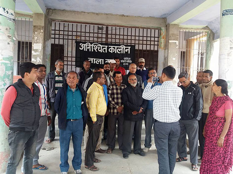 Nepal Lecturers' Association, the MBMC unit, Rajbiraj, and college staffers of Mahendra Bindeshwori Multiple Campus  protesting the merge of campus into Rajshri Janak University after padlocking the campus, in Rajbiraj in Saptari, on Sunday, February 25, 2018. Photo: RSS