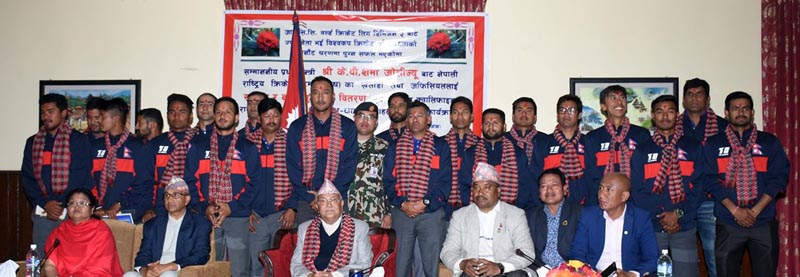 Nepal national cricket team members pose for a group photo with Prime Minister KP Sharma Oli (centre) and other officials in Baluwatar, Kathmandu on Friday.