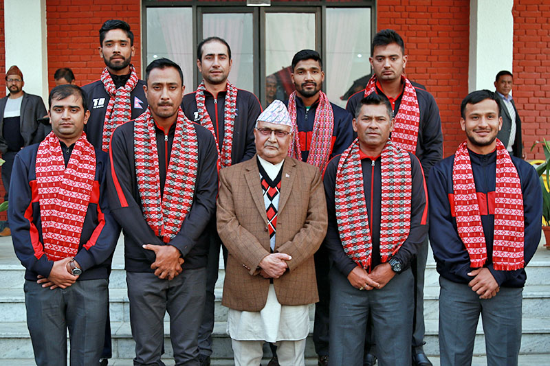 Prime Minister KP Sharma Oli along with Nepali cricketers pose for a portrait at PM's official residence at Baluwatar, Kathmandu, on Monday, February 19, 2018. Courtesy: PM's Office
